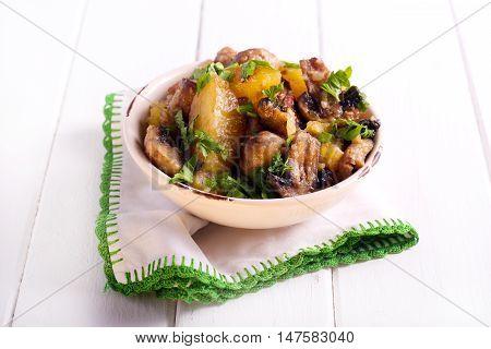 Sauteed potato and mushroom in a bowl