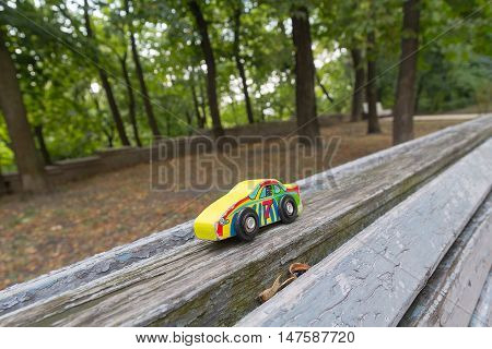 Forgotten children's toy on a bench in the park.