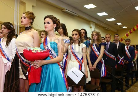 Moscow Russia - June 24 2016: Unidentified school pupils in formal dress and suit greeting their teachers in solemn graduation party festive day.