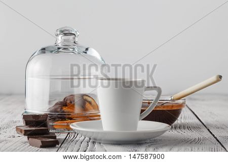 An Close-up View Of A Tiny Cup Of Espresso And Dried Orange