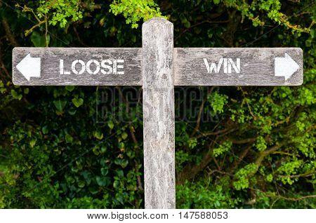 Loose Versus Win Directional Signs