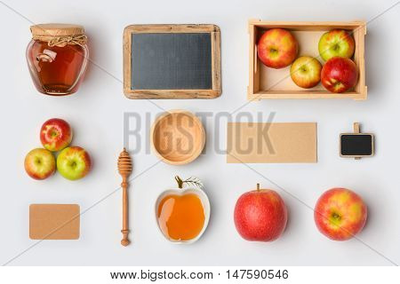 Jewish holiday Rosh Hashana mock up template with honey jarapples and chalkboard. View from above. Flat lay