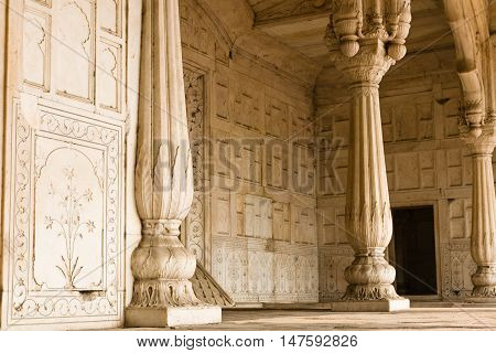 A decorated rich marble hall with pillars in the Red Fort of the Mughal Emperors in Old Delhi in India