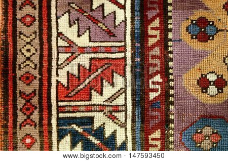 The edge ethnic woolen rug with sample of the folk geometric ornaments