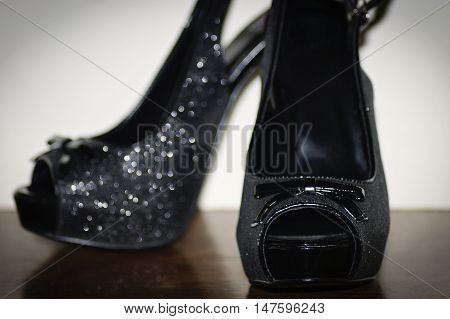 Fancy black shinny high heel shoes used for prom