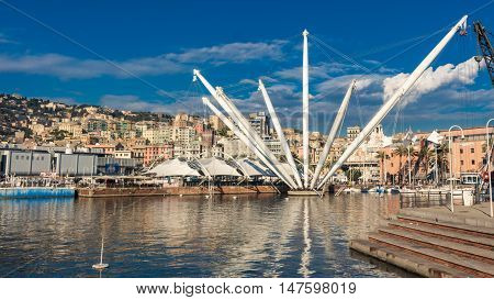 The Bigo is a 1992 building by Renzo Piano comissioned by the city and inspired from an ancient derrick for the ships servicing the old port of Genoa Italy. Its longest arm (above the vantage point) lifts a cabin with tourist for a nice view over the city
