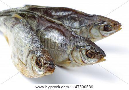 Three dried salt fish on white background