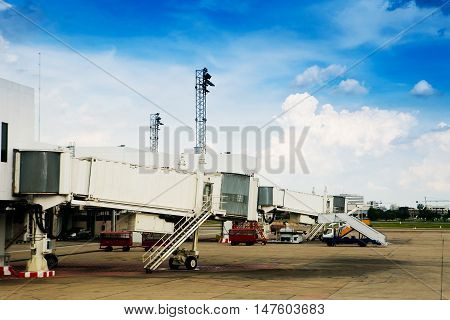 Empty jetway with airplane at the airport on loading on background