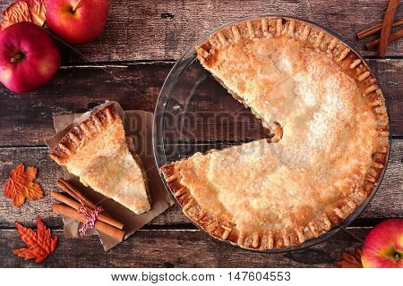 Autumn Apple Pie, Overhead Table Scene With Cut Slice On Rustic Wood