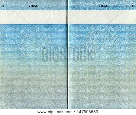 LONDON UK - OCTOBER 14 2014: Pages for visas marks in the old British Passport as background