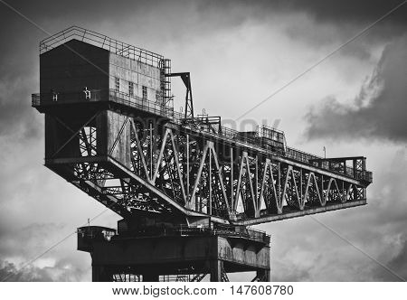 Black And White Image Of Industrial Shipbuilding Crane On The Clyde River In Glasgow