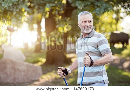 Recreation. Well fit senior citizen getting ready for a walk