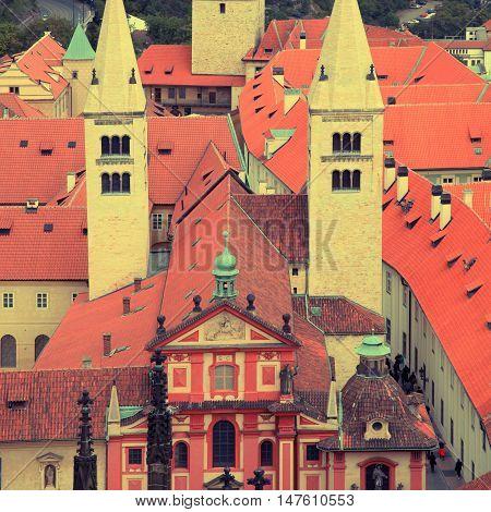Aerial view St.George's Basilica in Prague Castle (Pražský hrad) UNESCO world heritage site, Prague, Czech republic. Square vintage toned image