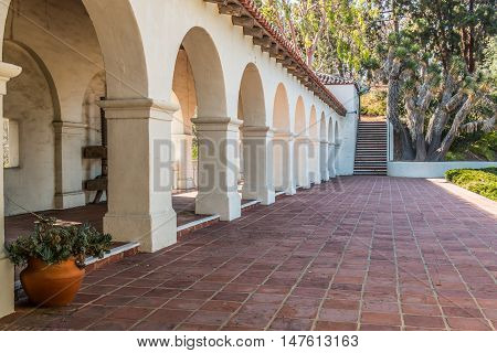 SAN DIEGO, CALIFORNIA - AUGUST 13, 2016: Columns and staircase of the Serra Mission Museum in Old Town, the former site of a fort and the first European settlement on the Pacific Coast.