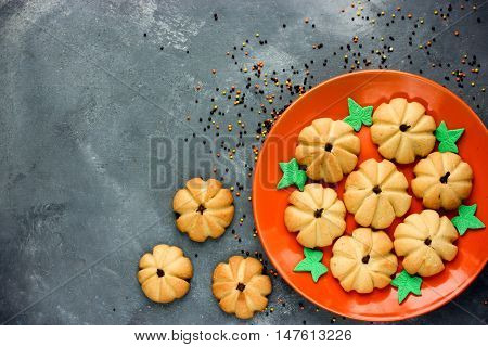 Halloween pumpkin cookies funny idea for Halloween party food top view copy space