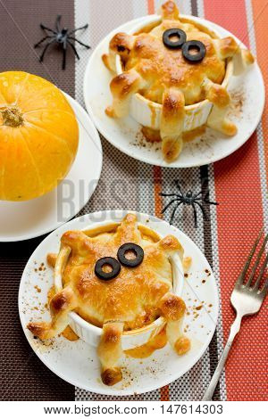 Halloween octopus pot pie. Tentacle pot pies. Portion pot pies with dough tentacles wrapping down the sides of the bowl. Funny idea for festive dinner. Adorable treats for Halloween party for kids