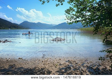 relaxing on a air mattress at lake tegernsee bavarian summer landscape