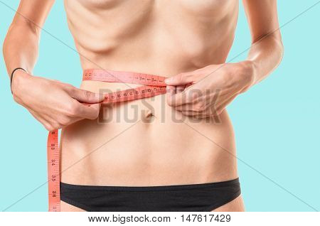 Underweight Young Woman Measuring Her Waist