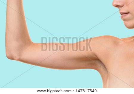 Young Blond Woman Showing Flabby Arm