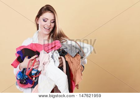 Happy Woman Carrying Dirty Laundry Clothes.