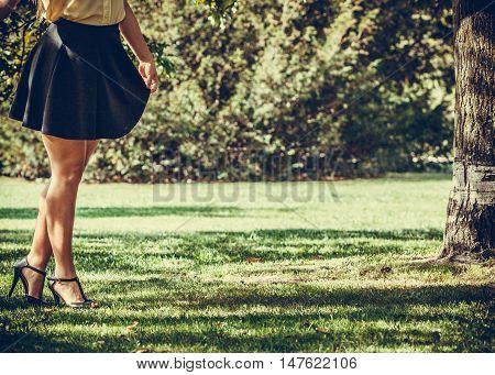 Female Legs In Park.