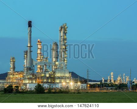 The refinery industry: this is oil refinery industry in Southeast Asia. In the picture a meadow Refinery and the glare of the sun on the left side of the image.