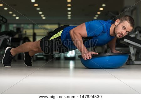 Personal Instructor Doing Push-ups With Bosu Balance Ball