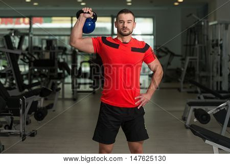Personal Trainer Exercising With Kettle-bell