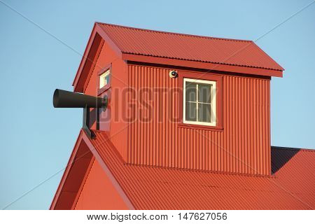 The horn of the foghorn sticks out of the building at Point Betsie Lighthouse, Michigan