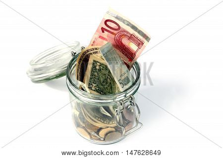 Glass bank with metal coins and banknotes