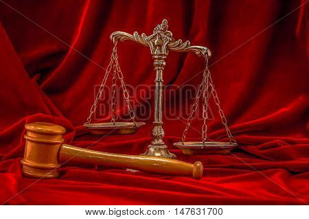 Symbol of law and justice on the red velvet background