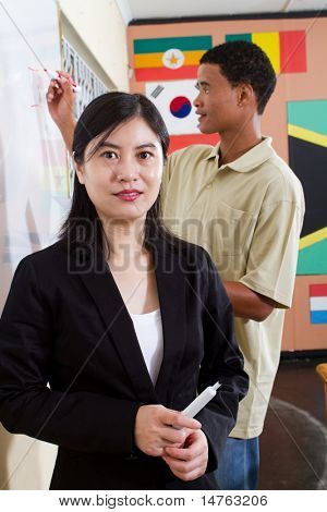 female chinese teacher portrait in classroom