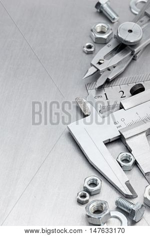 Vernier Caliper, Standard Ruler, Screws And Bolts On Scratched Metal Surface