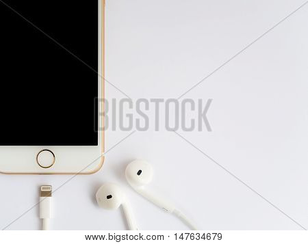 CHIANGRAI THAILAND -SEPTEMBER 9 2016: Close-up image of new Apple iPhone7 mockup and new Apple EarPods mockup on white background.