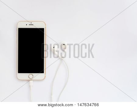 CHIANGRAI THAILAND -SEPTEMBER 9 2016: Front view image of new Apple iPhone7 mockup and new Apple EarPods mockup on white background with copy space.