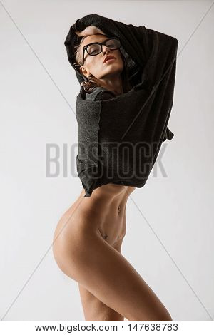 Young Naked Girl In Dress Posing In The Studio