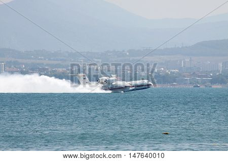 Gelendzhik Russia - September 9 2010: A pair of Beriev Be-200 amphibian planes is taking off from water surface of the sea