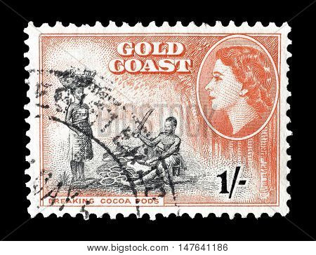 GOLD COAST - CIRCA 1952 : Cancelled postage stamp printed by Gold Coast, that shows Breaking cocoa pods.
