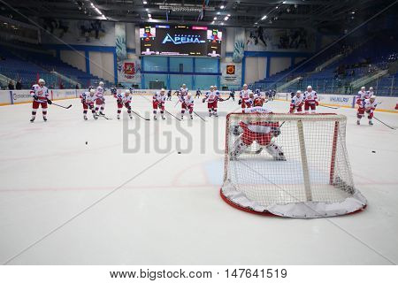 MOSCOW, RUSSIA - 14 OCT, 2015: Sportsmens with hockey-stick are playing on rink at hockey meet Dinamo Balashikha and Izhstal