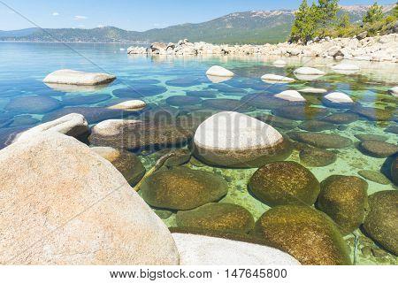 Beautiful boulders and crystal clear water of the lake Tahoe. Hidden Beach, Lake Tahoe - Nevada, USA