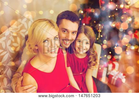 family, christmas, x-mas, winter, happiness and people concept - happy family at home