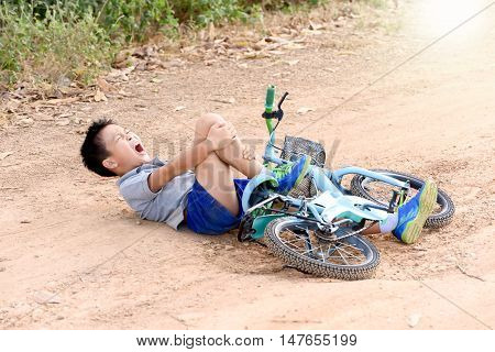 Boy Fall From The Bicycle During Ride On The Road
