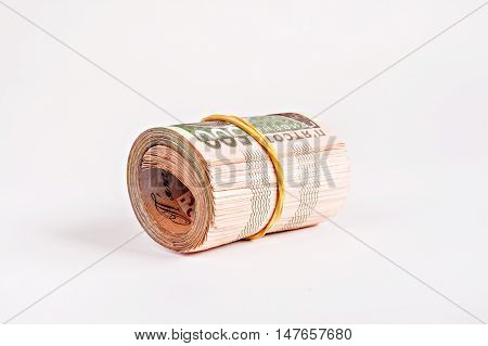 a pack of 500 hryvnia rolled isolated.