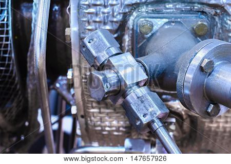 Details of old aircraft engine. Nuts connecting tubes, nozzles, combustion chamber insulation.