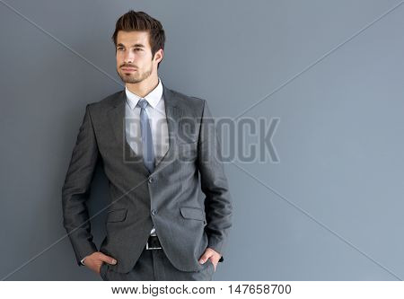 Young man in elegant man suit posing