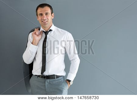 Nonchalant male model posing with jacket over shoulder