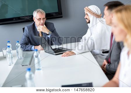 Director and Arabian partner on meeting in company