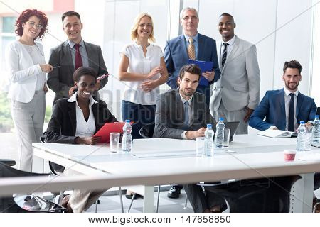 Young multiethnic business team posing in company