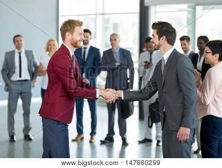 business partners handshaking in the sign of successful dealing