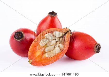 Rose hips with fruit cross-section over white. Rose haw or rose hep. Ripe red fruits, showing seeds with hairs. They can be used as itching powder. Shells are used for teas, jam and can be eaten raw.